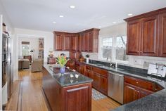 Gorgeous state of the art #kitchen with stainless  steel appliances, lots of counter space, and a fabulous dinette area! The rear glass slider to the deck makes this the perfect spot to entertain! #21sethlowmountainroad #ridgefieldct #thechipneumannteam #neumannrealestate #ctrealestate #ctlistings #beautifulhomes #forsale