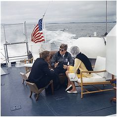 """JFK vacations in Maine aboard the U. Coast Guard cutter Guardian 1 in Boothbay Harbor. Seen here talking to Under Secretary of War Paul Fay and sister Patricia Kennedy Lawford, August John Kennedy, Patricia Kennedy, Les Kennedy, Jacqueline Kennedy Onassis, Jack Kirby, Captain America, Secretary Of The Navy, Familia Kennedy, Dallas"