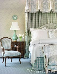 Patterns at play! Two different sizes of checks work with a trellis wallcovering in this pretty blue bedroom. - Photo:  Emily Jenkins Followill / Design: Will Huff and Heather Zarrett Dewberry