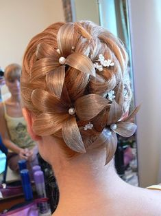 10 Wedding Hairstyles Gone Wrong. omg, flowers made out of hair is just awful