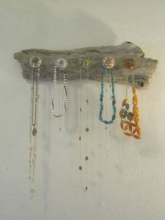I love this necklace holder! You can get really cool knobs from Anthropologie or World Market!