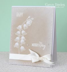handmade Mother's Day card ... kraft base with white ink and ribbon  ... white sponged edges ... faux stitched borders ... luv the stem of flowers with shading and extra detail done with a white gel pen ... Clearly Besotted ...