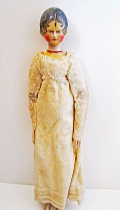This doll of 1810 would have been owned by a rich child as toys bought in shops were only afforded by very wealthy parents. The doll is dressed as a rich young lady would have been during the regency period. Poor children had to make do with toys carved from wood or bones by their parents or made from rags and scraps.