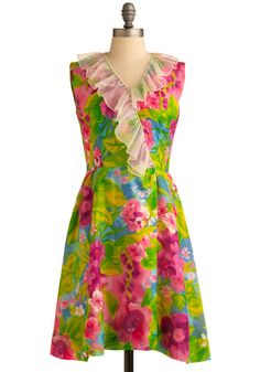 Bright multi-colored sleeveless dress with sheer ivory neckline ruffle, c. 1970's.