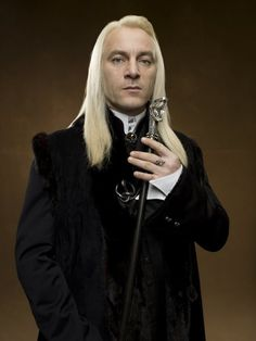 This board is not limited to real people...Lucius Malfoy is pretty frickin' hawt...