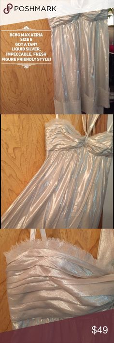 Dress Size 6 BCBG MAX AZRIA silver knee length BCBG MAX AZRIA Size 6.                                           Excellent pre-owned condition; Freshly cleaned and ready to wear.  Silver fabric with sheer voile trim layered over pewter lace at hemline creates a floaty effect.  Raw edges and eyelash trim soften the look, opening the possibility for more casual styling.     Softly defined cups with rubber edges to keep the bodice in place and center tie strap flatter the bust, while the body of…