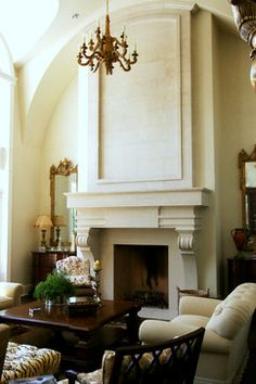 "The ""Renaissance"" stone fireplace mantel with custom curved Renaissance Over-mantel   Francois & Co.   Interiors by Eskuche Design"