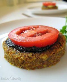 Raw Vegan burgers with mushroom sauce and tomato