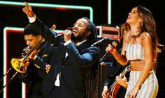 Rihanna performing during 2013 55th Annual Grammy Awards Bob Marley Tribute alongside Zigi and Damien Jr. Gong Marley, Bruno Mars & Sting