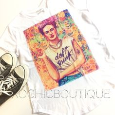 1LEFT Daft Punk Frida tee plus size avail Fun, comfy & chic!  This new and amazing line carried by Xochic Boutique!  Hand selected By me for you! Carrying sizes up to 4XL.  Sizes do run small, please see pictures for sizing!  Price firm unless bundled  If I don't have your size, please let me know and I can order your size with my next order. 100% polyester. Made in Mexico. Hand wash. Retail new with no tags. Xochic boutique Tops Tees - Short Sleeve