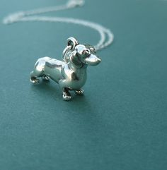 sterling silver dachshund necklace gift for her doxie wiener dog. $30.00, via Etsy.