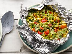Succotash -Toss 1 pound thawed frozen lima beans, 2 cups corn, 1 diced red bell pepper, 2 sprigs thyme, 2 tablespoons butter, and salt and pepper on a sheet of foil. Form a packet. Grill over medium-high heat, 10 minutes. Open and stir in 1/4 cup cream. Reseal; grill 10 more minutes. Top with chopped parsley.