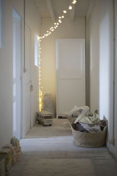 Simple and elegant #fairylight string canopy across a hallway to create mood lighting #stringlights