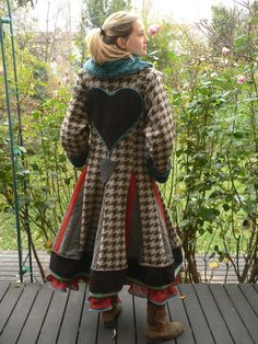❤ looks like the coat is just cut with slits and patchwork added