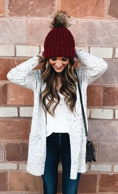 #winter #outfits red knit bobble hat and white long-sleeved cardigan