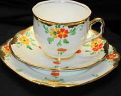 ROYAL ALBERT ENGLAND ORANGE FLOWER PAINTED TEA CUP AND SAUCER TRIO