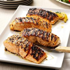 Grilled Lemon-Garlic Salmon Recipe -A lot of people fish for salmon here on the shore of Lake Michigan, so I've developed quite a few recipes for it, including this one. I love it, and so do my friends and family. When it's out of season, I look for wild- Grilling Recipes, Fish Recipes, Seafood Recipes, Cooking Recipes, Tilapia Recipes, Paleo Recipes, Cooking Tips, Fish Dishes, Seafood Dishes