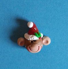 Monkey in Santa hat, polymer clay Christmas bead or hair bow center.. $3.25, via Etsy.
