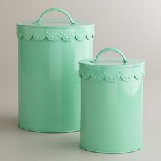 """Metal storage containers in aqua. Tops are oh-so-fancy with the """"lacy"""" edge. Pretty"""