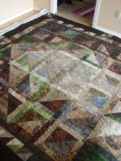 Progressive triangle batik....quilted by Charisma