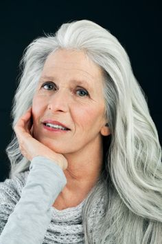 Mature woman with long, gray hair, portrait.