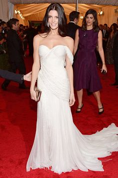 White grecian Donna Karan Atelier gown with chiffon pleats and a stone encrusted sequin bustier.