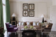 This Hyde Park townhouse living area, with dark wood flooring, stately wood details, and plum-colored accents, is by 2014 A-list designer Paolo Moschino.