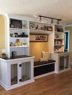 Dog kennels, bench seat with storage and built in bookshelves.