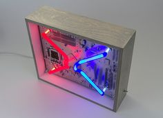 We create [dys]functional spectr-objects using recycled electronics and light. Machine Age, Silver Paint, Light Decorations, Wooden Frames, Recycling, Objects, Neon, Create, Instruments