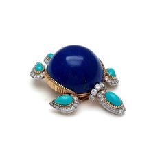 A lapis lazuli, turquoise and diamond turtle brooch, by Cartier, 1960s. @cartier #turtlebrooch #natureinspiredjewelry #finejewelry