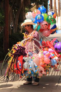 This is like one of the pictures I have of Tijuana in my head, all those years ago.  Toy Vendor ~ by Roupen  Baker