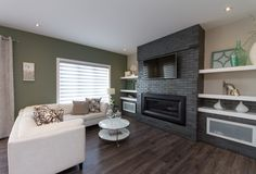 Willow Creek Showhome Living room, two-tone wall, fireplace and mounted t. Two Tone Walls, Living Area, Living Room, Willow Creek, Mounted Tv, Build Your Dream Home, Home Builders, Home Decor, Decoration Home