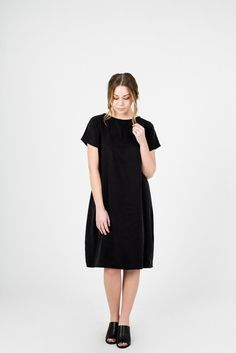Cocoon Dress- A truly versatile dress that looks great on all body types. With a slight cocoon shape, it hits just below the knee and can be layered with pants or worn alone.