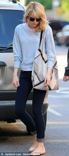 blue light sweater, skinny jeans, and a flat shoes.  (Emma Stone)