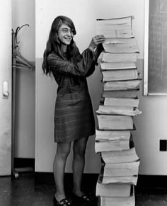"Margaret Hamilton is a computer scientist and mathematician. She was the lead software engineer for Project Apollo.  Her work prevented an abort of the Apollo 11 moon landing. She's also credited for coining the term ""software engineer.""   Those stacks are the code she wrote for Apollo 11. Incredible."