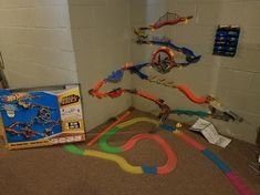 We assemble a wall mounted track play system for you and your children.