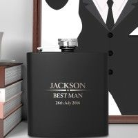 Our Heritage Wedding Personalised Luxury Black Hip Flask is a fantastic wedding gift. Imagine the look on your best man's face when you present him with this personalised keepsake. He is bound to treasure it forever. The black hip flask has been crated using only the highest quality materials. It offers a sleek and modern black finish with silver hardware. It is truly spectacular on its own and even better when adorned with your special details. On the front of the hip flask, in eye-catching…