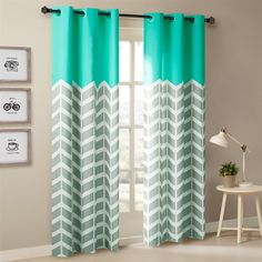 Our Chevron Printed Panel Pair is the perfect update for some fun color and print. Top of the panel features solid bright aqua for a refreshing pop of color, combined with a grey and white chevron duo for a modern update. The panel is finished with foamback lining for room darkening features, added privacy, and energy saving abilities. Grommet top detail makes it easier to hang, open, and close panels throughout the day. Fits up to 1.25
