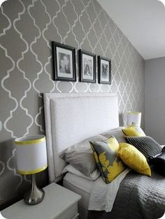 Grey and yellow master bedroom. Love the bold pattern behind the bed.