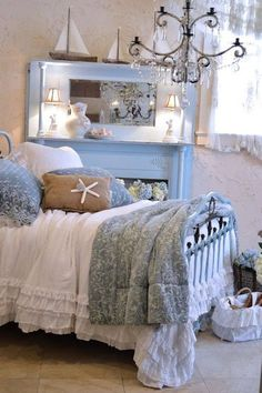 Shabby chic romantic beach bedroom in soft blue, some driftwood touches and…
