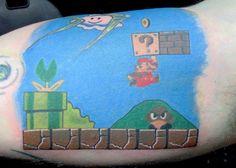 http://globalgeeknews.com/wp-content/uploads/2011/11/Super-Mario-Bros-Tattoo.jpg