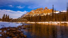 castle mountain sunset - This took a bit of effort to climb down from the bridge and walk on the snowbank. Here I wanted the bridge in the shot. This was at sunset in winter near Banff. Mountain Sunset, Banff, Rocky Mountains, Mount Everest, Tourism, Castle, Journey, Earth, River