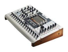 The Arturia Origin is a big white synthesizer. It has a hand rest like an old studio console or an MPC60 (unfortunately curved steel, not pleather, but still...) It's made in France, of all places. It's a digital modular synth, containing models of oscillators and filters from Moog, Arp, Roland and Yamaha, plus a VS-style wavetable section.