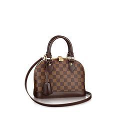 Discover Louis Vuitton Alma BB: The charming Alma BB traces its pedigree to the original Art Deco icon, introduced in 1934. This miniature version in Damier Ebène canvas easily holds keys, wallet, smartphone and lipstick. With a strap that adjusts the bag to waist or hip height, the Alma BB can be worn across the body for hands-free ease.