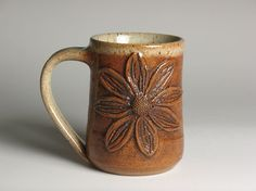 Stoneware pottery mug with flower by brentsmithpottery