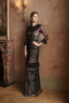 Channel an ethereal style in the Shadow Lace Gown finished in black lace. This long-sleeved floral embroidered maxi dress is finished with ruffled cuffs and a cinched waist for modern femininity, whilst the sheer tulle layer falls delicately over a nude underpinning.