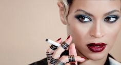 Beyonce wears Bright Plum Lipstick in Haunted Video