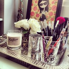 bathroom counter...love the idea to use glasses for makeup brushes and a silver tray adds elegance.