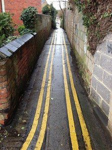 From the BBC - Narrow Swindon alleyway painted with double yellow lines