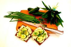 Pura Vida sprouted raw broccoli bread with cashew and pickled cabbage topping served with sliced cucumbers and chives!